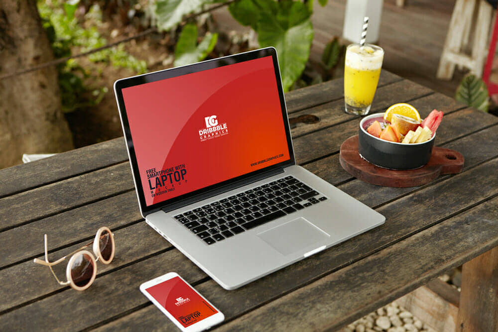 Holiday Scene Smartphone & Laptop Mockup on Wooden Table