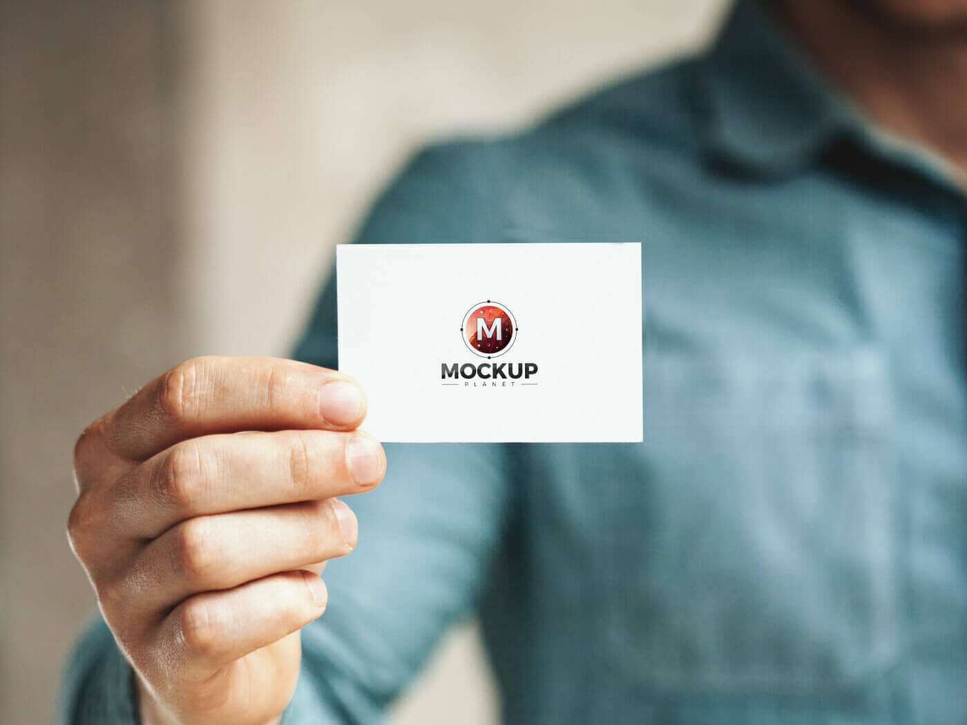 Free Man Holding in Hand Business Card Mockup