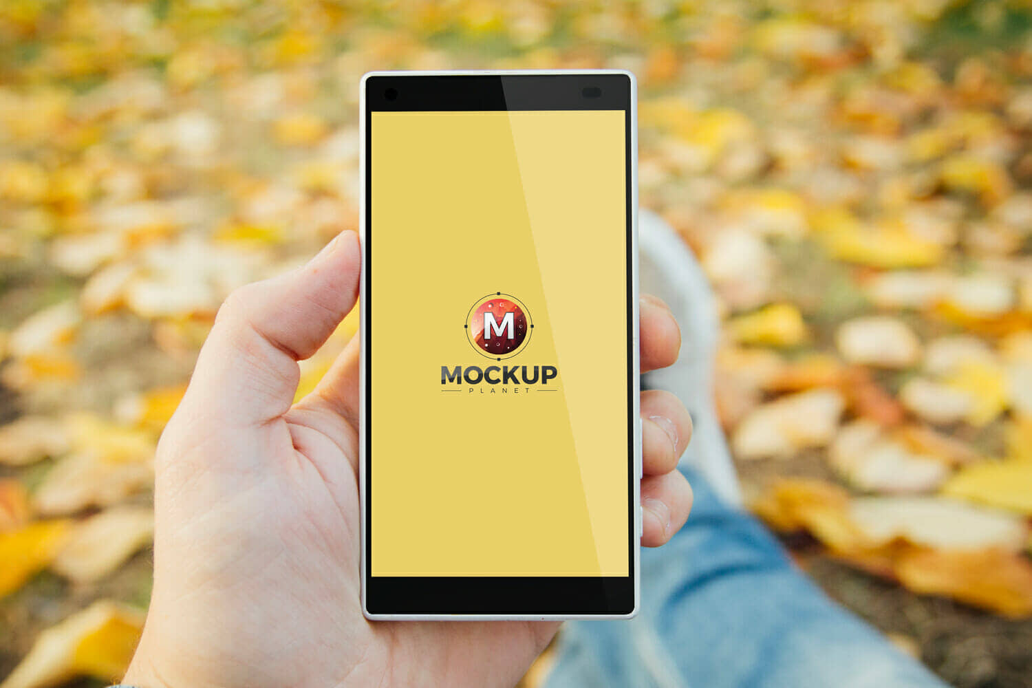 Free Man in Park Holding Smartphone Mockup