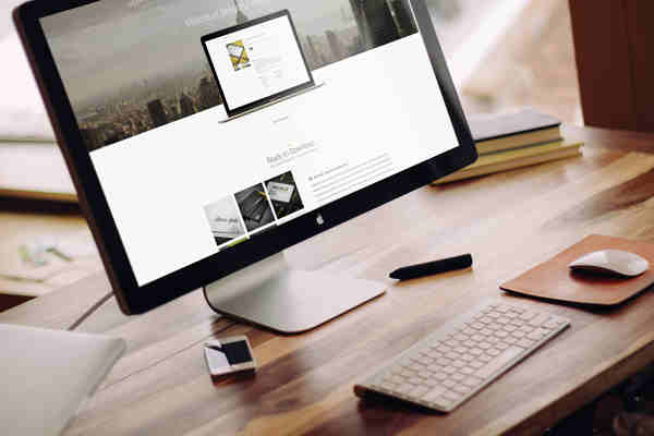 Apple iMac on a Wooden Table Mockup
